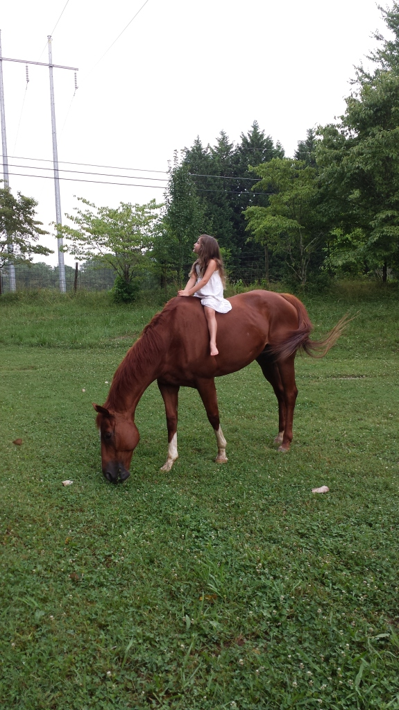 My daughter riding Baron